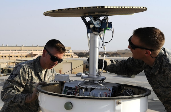 U.S. Air Force Staff Sgt. Gregory Evenson and Senior Airman David Baily, 386th Expeditionary Operations Support Squadron weather forecasters, conduct a preventative maintenance inspection on a Doppler radar system at an undisclosed location in Southwest Asia, Oct. 16, 2015. Forecasters use the radar equipment and traditional observation techniques to aid aircraft flying in support of Operation INHERENT RESOLVE. (U.S. Air Force photo by Staff Sgt. Tyler Alexander/Released)