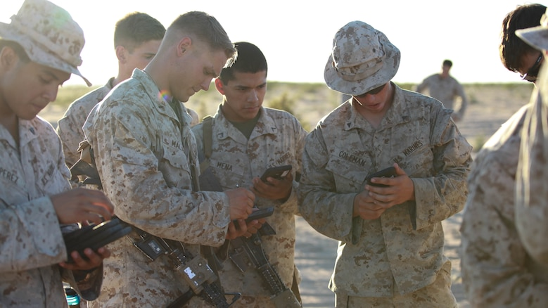 Marines with Fox Company, 2nd Battalion, 7th Marine Regiment use tablets to help them in a training exercise at Marine Corps Air Station Yuma, Arizona, Oct. 14, 2015. The tablets are wirelessly connected through an encrypted internal Wi-Fi network allowing Marines to coordinate and maneuver more efficiently in a tactical environment while securely using various applications on the devices.