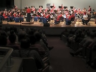 "Musicians with the ""The President's Own"" Marine Corps Band stun the crowd with their performance at the Woodrow Wilson High School auditorium Sept. 16, 2015, in Beckley, West Virginia. The band's mission is to perform for the President of the United States and the Commandant of the Marine Corps, but is celebrated for its role at the White House and its annual schedule of more than 500 dynamic public performances. (U.S. Marine Corps photo by Sgt. Caitlin Brink/Released)"