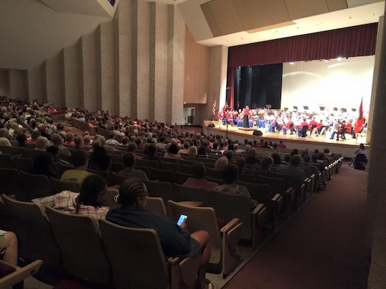 """Musicians with the """"The President's Own"""" Marine Corps Band stun the crowd with their performance at the Woodrow Wilson High School auditorium Sept. 16, 2015, in Beckley, West Virginia. The band's mission is to perform for the President of the United States and the Commandant of the Marine Corps, but is celebrated for its role at the White House and its annual schedule of more than 500 dynamic public performances. (U.S. Marine Corps photo by Sgt. Caitlin Brink/Released)"""