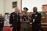 DLA Distribution commander Army Brig. Gen. Richard Dix, on right, and Deputy Commanding General, National Guard Army Brig. Gen. John King, left, present veteran Army Sgt. Earnest Felton Jett, Sr., with medals and badges for his service in World War II.