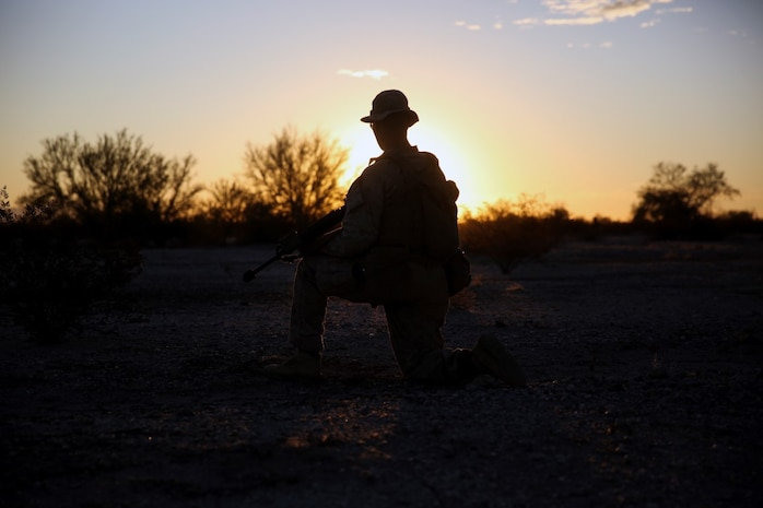 Lance Cpl. Paul Hameister, a rifleman assigned to Company E, 2nd Battalion, 7th Marine Regiment, 1st Marine Division, takes a knee during a patrol to survey the area during Talon Exercise 1-16 at Marine Corps Air Station, Yuma, Ariz., Oct. 14, 2015. The training took place at Baker's Peak, a rugged desert training area located on the approximately 1,700,000 acre Barry M. Goldwater Range and was part of a larger event called Talon Exercise, which focused on offensive and defensive operations in desert and urban environments.