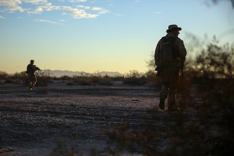 Marines assigned to Company E, 2nd Battalion, 7th Marine Regiment, 1st Marine Division, scan the area during a patrol as part of Talon Exercise 1-16 at Marine Corps Air Station, Yuma, Ariz., Oct. 14, 2015. The training took place at Baker's Peak, a rugged desert training area located on the approximately 1,700,000 acre Barry M. Goldwater Range and was part of a larger event called Talon Exercise, which focused on offensive and defensive operations in desert and urban environments.
