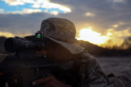 Lance Cpl. Anthony Sarmiento, a rifleman assigned to Company E, 2nd Battalion, 7th Marine Regiment, 1st Marine Division, provides security while establishing a defensive position during Talon Exercise 1-16 at Marine Corps Air Station, Yuma, Ariz., Oct. 12, 2015. The training took place at Baker's Peak, a rugged desert training area located on the approximately 1,700,000 acre Barry M. Goldwater Range and was part of a larger event called Talon Exercise, which focused on offensive and defensive operations in desert and urban environments.