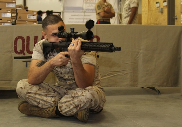 U.S. Marine Corps Sgt. Michael C. Martinez, a recruiter with Marine Corps Recruiting Sub Station Aberdeen, former marksmanship instructor, and Challis, Idaho, native, demonstrates a proper seated position to a group of poolees during a pool function at Quantico Tactical in Aberdeen, North Carolina, Oct. 10, 2015. The Marines taught the poolees proper weapons handling, aiming and marksmanship to give them a unique experience and teach them skillsets that will be useful at recruit training. (U.S. Marine Corps photo by Sgt. Dwight A. Henderson/Released)