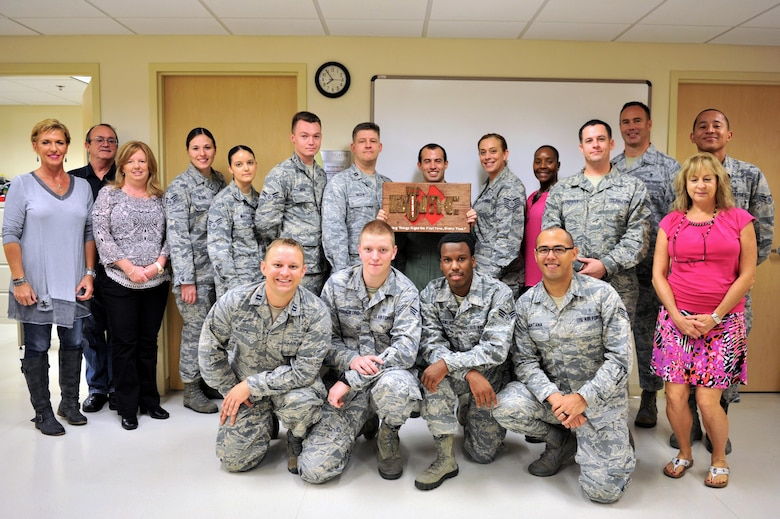 Members of the Base Operation Medicine Cell take a group photo after hosting a grand opening at the Keesler Medical Center, Sept. 28, 2015, Keesler Air Force Base, Miss. The Keesler BOMC is working to adjust Air Force healthcare by standardizing Public Health Assessments, Deployment Health Assessments, flight physicals and clearance physicals in order to make direct patient care more accessible, personal and timely. This clinic is the first of its kind in the Air Force. (U.S. Air Force photo by Airman 1st Class Duncan McElroy)