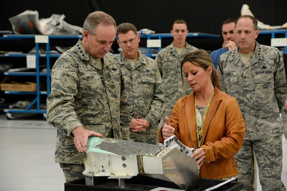 Eileen Frock, 570th Aircraft Maintenance Squadron operations officer, briefs Air Force Chief of Staff Gen. Mark A. Welsh III on an F-35 replacement modification at Hill Air Force Base, Utah, Oct. 15, 2015. The part depicted, a root rib, was removed from an F-35 airframe and a stronger replacement added, extending the aircraft's service life. During his visit, Welsh received an overview of Ogden Air Logistics Complex facilities and operations. (U.S. Air Force photo/R. Nial Bradshaw)