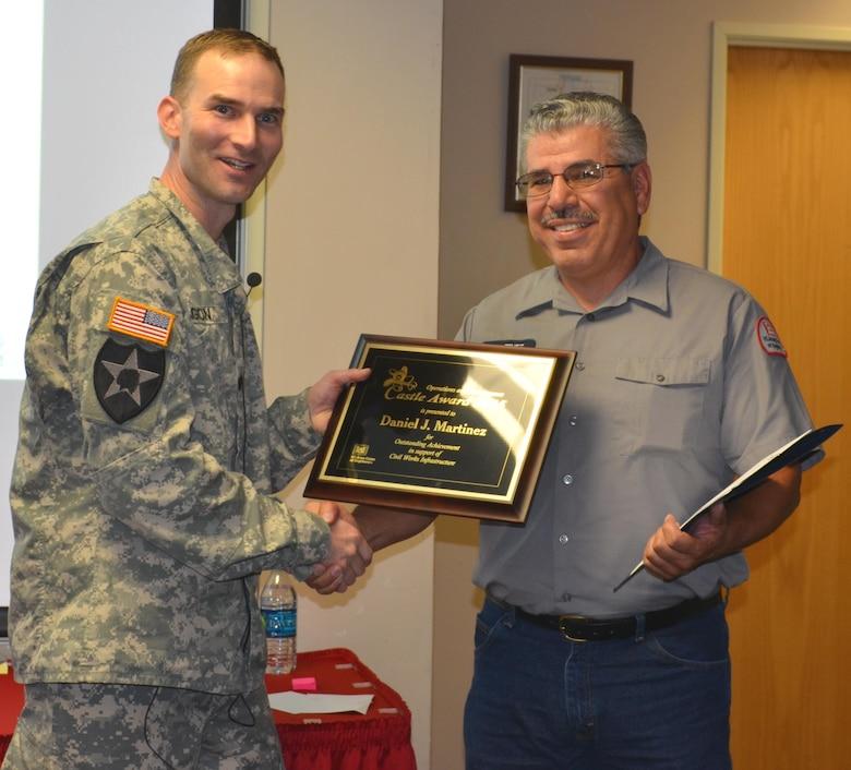 ALBQUERQUE, N.M. – District Commander Lt. Col. Patrick Dagon presents Daniel J. (Joe) Martinez with the Castle Award, Oct. 6, 2015.