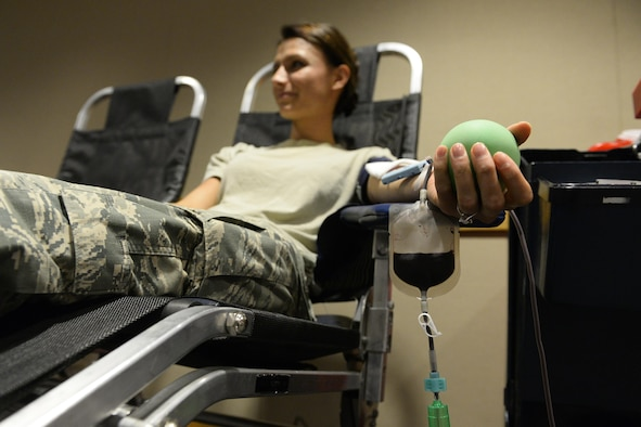 First Lt. Fanita Schmidt, a 4th Space Operations Squadron orbital analysis engineer, donates blood at the 3rd annual blood drive hosted by the 21st Medical Dental Squadron at Schriever Air Force Base, Colo., Oct. 6, 2015. Schmidt explained her decision to donate was based on personal experiences from her childhood, when she received a blood transfusion after a devastating car wreck. (U.S. Air Force photo/Christopher DeWitt)