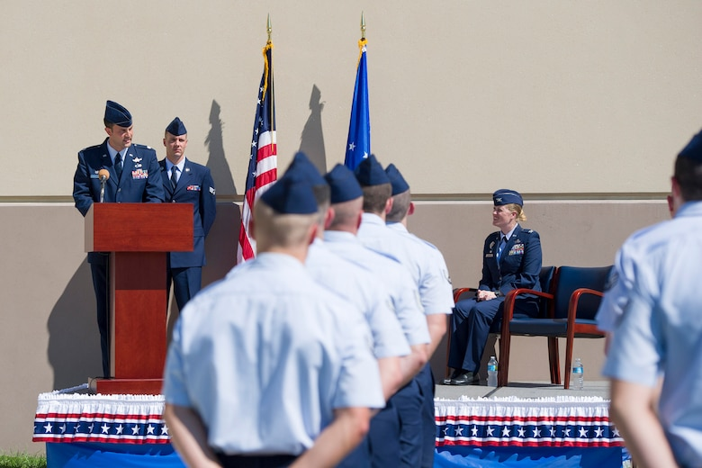 Col. Jennifer P. Sovada (right), the Air Force Technical Applications Center commander, looks on as Lt. Col. Ehren Carl delivers his first remarks after assuming command of AFTAC's Technical Surveillance Squadron at Patrick AFB, Fla., Oct. 15, 2015. Carl is the first officer to assume command of one of five newly-formed squadrons at AFTAC. (U.S. Air Force photo/Matthew Jurgens)