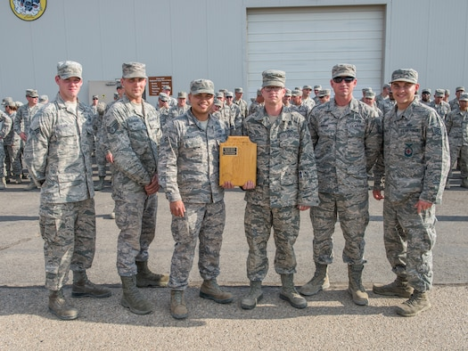 (From the left) Senior Airman Dennis Clark, Staff Sgt. Tyler Ford, Airman 1st Class Joshuajun Manuel, Senior Airman Blake Dillon, Tech. Sgt. Matthew Gibson and Staff Sgt. Derek Hansen pose for a photo after being declared the 3rd annual CE Readiness Challenge Champions Oct. 15, 2015 at Mountain Home Air Force Base, Idaho. The airmen are assigned to various sections in the squadron and came together for a look at how each other's jobs are done. (U.S. Air Force photo by Airman 1st Class Connor J. Marth)