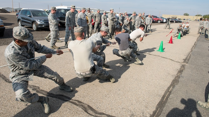 Team Martinez (left) and Team Gibson compete in a tug-of-war battle for a tie-breaking shot at first place in the 3rd annual CE Readiness Challenge Oct. 15, 2015 at Mountain Home Air Force Base, Idaho. Each team won points based on performance on completion of 10 challenges set-up across the base. (U.S. Air Force photo by Airman 1st Class Connor J. Marth)