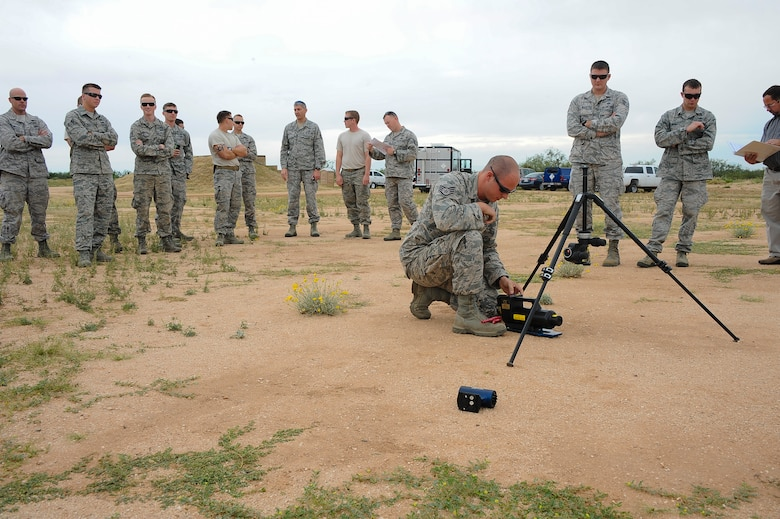U.S. Air Force Staff Sgt. Patrick Barbarino, 355th Civil Engineer Squadron explosive ordnance disposal technician, reattaches an X-ray generator to a tripod during advanced X-ray training at Davis-Monthan Air Force Base, Ariz., Oct. 15, 2015. EOD technicians from D-M AFB, Luke AFB, Ariz., Edwards AFB, Calif., Cannon AFB, N.M. and Naval Air Station Joint Reserve Base Fort Worth, Texas, attended the training. (U.S. Air Force photo by Airman 1st Class Mya M. Crosby/Released)