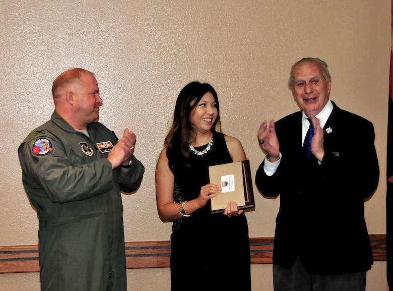 U.S. Air Force Col. Chris Triebel, 161st Air Refueling Wing vice commander, and Edward Scannell, Tempe Military Affairs Committee chair, present the Tech. Sgt. Donald Plough award to Jocelyn Bautista on behalf of her husband Master Sgt. Jesse Bautista during a ceremony Oct. 14, 2015,  at the wing.  Bautista is currently attending in-residence Senior Non-commissioned Officer Academy at Maxwell Air Force Base, Ala.  (U.S. Air National Guard photo by Master Sgt. Kelly Deitloff)