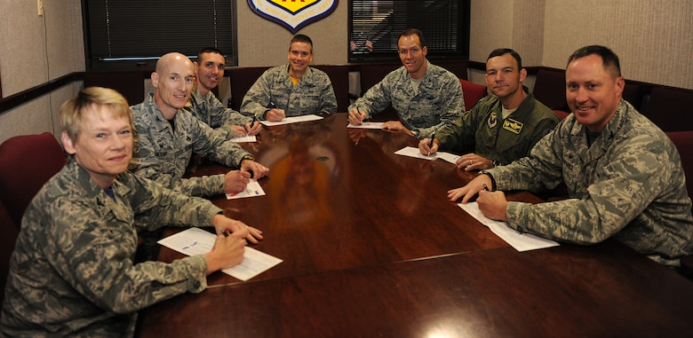 Leadership from the 509th Bomb Wing sign their Combined Federal Campaign (CFC) pledge cards Oct. 16, 2015, at Whiteman Air Force Base, Mo. The CFC is comprised of 141 local campaigns that organize an annual fund raising effort in federal workplaces. (U.S. Air Force photo by Airman 1st Class Michaela R. Slanchik/Released)