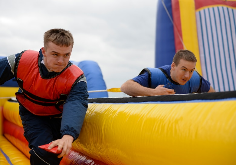 U.S. Air Force Airman 1st Class Austin Moriarty, 509th Munitions Squadron weapons maintenance team member, right, races Capt. James Passmore, 509th Medical Operations Squadron physical therapist, on the two-man bungee run during Wingman Day, Oct. 9, 2015, at Whiteman Air Force Base, Mo. Events were held throughout the day to strengthen and sustain a resilient Air Force community that values mental, physical, social and spiritual fitness. (U.S. Air Force photo by Senior Airman Sandra Marrero/Released)