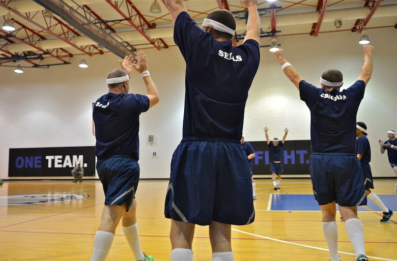 "Members of the Whiteman Chiefs' group celebrate after a dodgeball victory against the ""Eagles"" during Wingman Day, Oct. 9, 2015 at Whiteman Air Force Base, Mo. The wing held activities that emphasized mental, physical, social and spiritual fitness. The ""Eagles"" displayed resilience and came back to win the series against the Chiefs. (U.S. Air Force photo by Tech. Sgt. Miguel Lara III/Released)"
