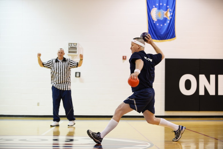 "U.S. Air Force Chief Master Sgt. Craig Smith, 509th Maintenance Squadron low observable superintendent, throws a ball toward members of the ""Eagles"" during a dodgeball game on Wingman Day, Oct. 9, 2015 at Whiteman Air Force Base, Mo.  Events were held throughout the day to inform and educate Airmen about available resources and the importance of resiliency. (U.S. Air Force photo by Tech. Sgt. Miguel Lara III/Released)"