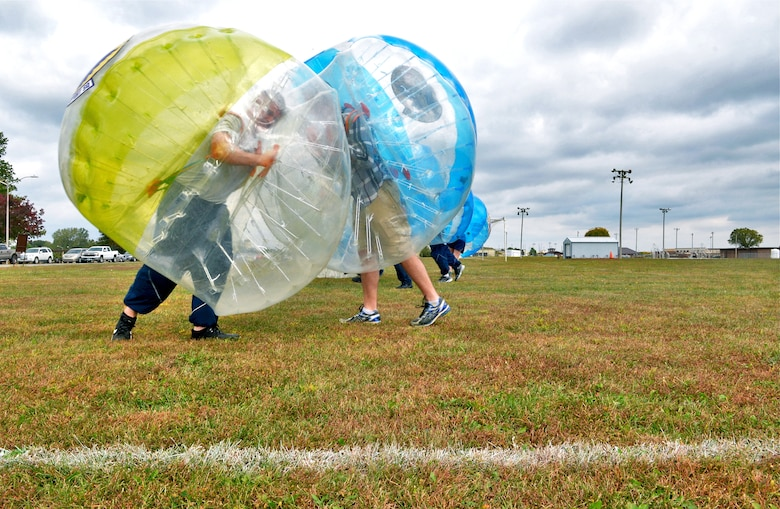 Whiteman Warriors clash during a bubble-soccer game as part of Wingman Day, Oct. 9, 2015 at Whiteman Air Force Base, Mo. The wing held activities that contributed to mental, physical, social and spiritual fitness. (U.S. Air Force photo by Tech. Sgt. Miguel Lara III/Released)