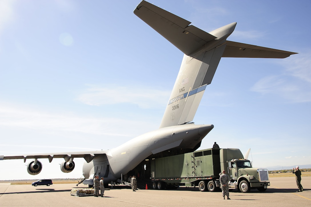 Colorado Air National Guard Airmen from the 233d Space Group, Greeley Air National Guard Station, load a Mission Vehicle 118 onto a C-17 Globemaster III at Buckley Air Force Base, Colo., Oct. 17, 2015. This exercise is part of the 140th Wing's four-day wartime readiness inspection, which is an implementation of the new Air Force Inspection System, and will assess the wing's ability to perform their combat missions. (U.S. Air National Guard photo by Tech. Sgt. Nicole Manzanares)