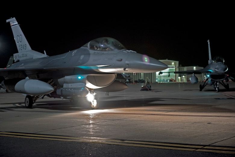 An F-16 Fighting Falcon from the 120th Fighter Squadron, Colorado Air National Guard, prepares for take off during a night mission for the Wing Wartime Readiness Inspection, Buckley Air Force Base, Colo., Oct. 16, 2015. The WWRI is a four-day inspection that tests and evaluates the 140th Wing on critical requirements to ensure mission readiness for real world deployments. (U.S. Air National Guard photo by Senior Airman Michelle Y. Alvarez-Rea)