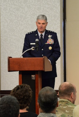 Lt. Gen. Samuel Cox speaks to members of 18th Air Force during his Assumption of Command ceremony at the Scott Club on Scott Air Force Base, Oct. 19, 2015. As 18th AF commander, Cox will lead Air Mobility Command's operational mission as Air Forces Transportation, the air component of U.S. Transportation Command. He is responsible for the command's worldwide operational mission of providing rapid, global mobility and sustainment for America's armed forces through airlift, aerial refueling, aeromedical evacuation, and contingency response. Additionally, Cox also commands Task Force 294, which oversees Air Force tanker operations in support of U.S. Strategic Command. (U.S. Air Force photo by Master Sgt. Thomas J. Doscher