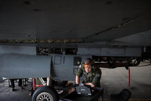 U.S. Air Force Staff Sgt. Matthew Lawson assigned to the 455th Expeditionary Maintenance Squadron, works to complete a 400-hour phase inspection on an F-16 Fighting Falcon aircraft Oct. 18, 2015, at Bagram Airfield, Afghanistan. The 455th EMXS Airmen completed 32 phases during their six month deployment topping the average by 33 percent (U.S. Air Force photo by Tech. Sgt. Joseph Swafford/Released)