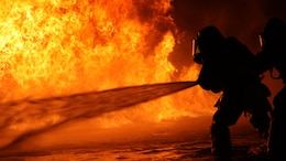 Aircraft Rescue and Firefighting Marines tackle some of their first fuel fires at Marine Corps Air Station Cherry Point, N.C., Oct. 16, 2015. The training exercise taught the new Marines how to battle the heat and keep pushing until they annihilate the flames, as well as get used to the environment of a real fire.