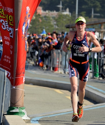 U.S. Air Force Maj. Judith Coyle runs the last leg of the women's triathlon in downtown Pohang, South Korea, during the CISM World Games Oct. 10, 2015. Coyle earned bronze for the USA with an overall time of two hours, 15 minutes and 27.69 seconds in the triathlon.