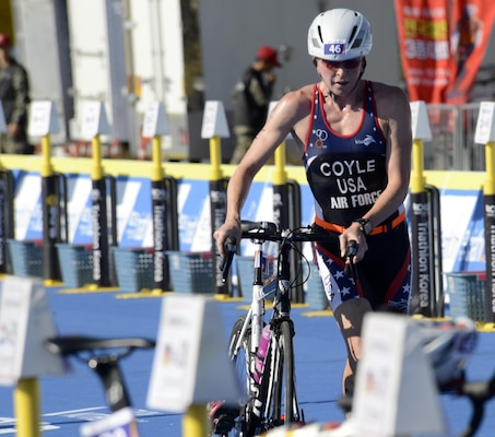 U.S. Air Force Maj. Judith Coyle pulls her bike out of the rack to begin the 40-kilometer cycling leg of the women's triathlon in Pohang, South Korea, during the CISM World Games Oct. 10, 2015. Coyle earned a bronze medal in the women's senior division.