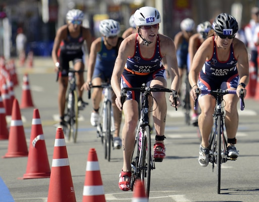 U.S. Army 2nd Lt. Justine Emge (right) and Air Force Maj. Judith Coyle race the 40-kilometer cycling leg of the women's triathlon in downtown Pohang, South Korea during the CISM World Games Oct. 10, 2015. Coyle earned bronze for the USA with an overall time of two hours, 15 minutes and 27.69 seconds in the triathlon.