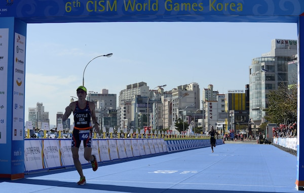 U.S. Air Force Maj. Judith Coyle crosses the finish line of the women's triathlon in downtown Pohang, South Korea, during the CISM World Games Oct. 10, 2015. Coyle earned bronze for the USA in the seniors division with an overall time of two hours, 15 minutes and  27.69 seconds.