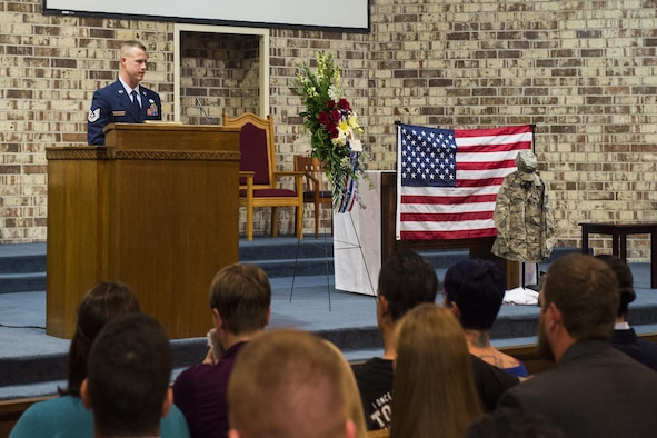 Tech. Sgt. Michael Sessions, the 723rd Aircraft Maintenance Squadron assistant first sergeant, addresses Airman, family and friends in attendance during Tech. Sgt. Marissa Hartford's memorial ceremony at the base chapel on Moody Air Force Base, Ga., Oct. 16, 2015. Sessions emphasized what an honor it was to serve alongside Hartford and the mark she left on his life and others. (U.S. Air Force photo/Senior Airman Ceaira Tinsley)