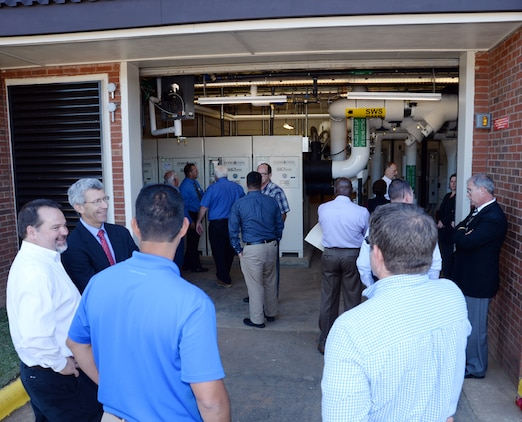 Attendees tour America's first Borehole Thermal Energy Storage system - a state-of-the-art ground source heat pump system – after a ribbon-cutting ceremony at Building 3700, here, Oct. 19.