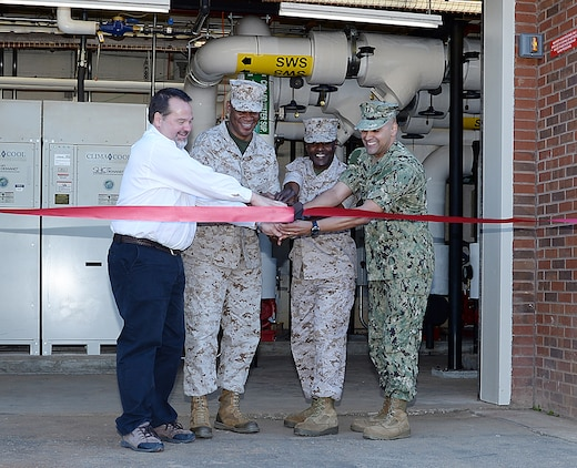 Military and civilian leaders officially mark the start of America's first Borehole Thermal Energy Storage system - a state-of-the-art ground source heat pump system – with a ribbon-cutting ceremony at Building 3700, here, Oct. 19. From left: Chuck W. Hammock Jr., principal engineer, Andrews, Hammock & Powell, Inc., Macon, Ga.; Maj. Gen. Craig C. Crenshaw, (second from left) commanding general, Marine Corps Logistics Command;  Col. James C. Carroll III (third from left), commanding officer, MCLB Albany; and Navy Lt. Jose Centenorosado, director, Facilities Engineering and Acquisition Division, MCLB Albany.