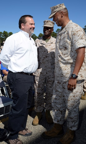 Chuck W. Hammock Jr., (left) principal engineer, Andrews, Hammock & Powell, Inc., Macon, Ga., discusses the implementation of America's first Borehole Thermal Energy Storage system - a state-of-the-art ground source heat pump system – at Marine Corps Logistics Base Albany with Maj. Gen. Craig C. Crenshaw, (right) commanding general, Marine Corps Logistics Command, and Col. James C. Carroll III (center), commanding officer, MCLB Albany, Oct. 19.