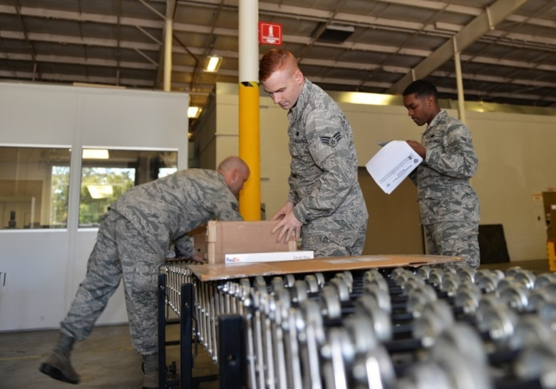 Airmen of the 96th Logistics Readiness Squadron process equipment and supplies for the F-35A and C variants for delivery at Eglin Air Force Base, Fla., Oct. 15, 2015. Materiel management Airmen prioritize equipment deliveries to help keep the 33rd Fighter Wing student pilots in the air and the 5th generation fighter moving forward to initial operational capabilities. (U.S. Air Force Photo/Senior Airman Andrea Posey)