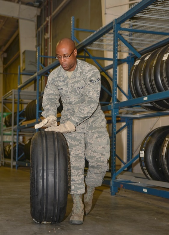 Airmen 1st Class Kristopher Adams, 96th Logistics Readiness Squadron F-35 supply apprentice, prepares a tire for delivery at Eglin Air Force Base, Fla., Oct. 15, 2015. Materiel management Airmen handle aircraft parts to maintain the F-35 Lightning II aircraft here. (U.S. Air Force Photo/Senior Airman Andrea Posey)
