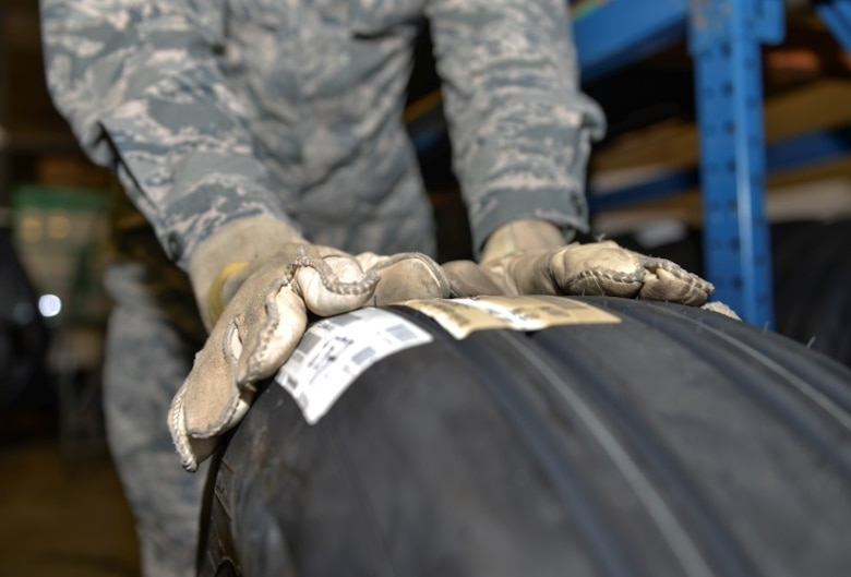 Airmen 1st Class Kristopher Adams, 96th Logistics Readiness Squadron F-35 supply apprentice, prepares a tire for delivery at Eglin Air Force Base, Fla., Oct. 15, 2015. Supplies from the warehouse go to multiple units such as the 58th Aircraft Maintenance Unit, 33rd Aircraft Maintenance Squadron, Navy Strike Fighter Squadron 101 Grim Reapers and the Air Education Training Command Academic Training Center. (U.S. Air Force Photo/Senior Airman Andrea Posey)