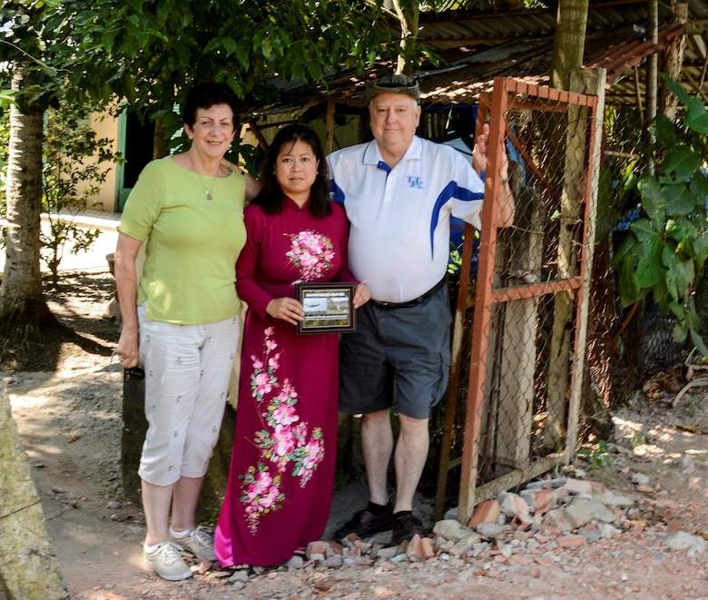 From left, retired Lt. Col. Regina Aune, Aryn Lockhart and retired Chief Master Sgt. Ray Snedegar pause for a photo after showing their respects at a shrine for those lost after the crash of a C-5A in Saigon, Vietnam, in April 1975.