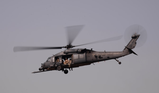 A U.S. Air Force HH-60 Pavehawk takes off Oct. 16, 2015, at Osan Air Base, Republic of Korea. The helicopter is assigned to the 33rd Rescue Squadron from Kadena Air Base, Japan, and maintained by members of the 718th Aircraft Maintenance Squadron. Both squadrons along with other members of the Air Force, U.S. Marines, and the Republic of Korea Air Force are working together participating in the joint, combined combat search and rescue exercise Pacific Thunder 15-02. (U.S. Air Force photo by Staff Sgt. Benjamin Sutton/Released)