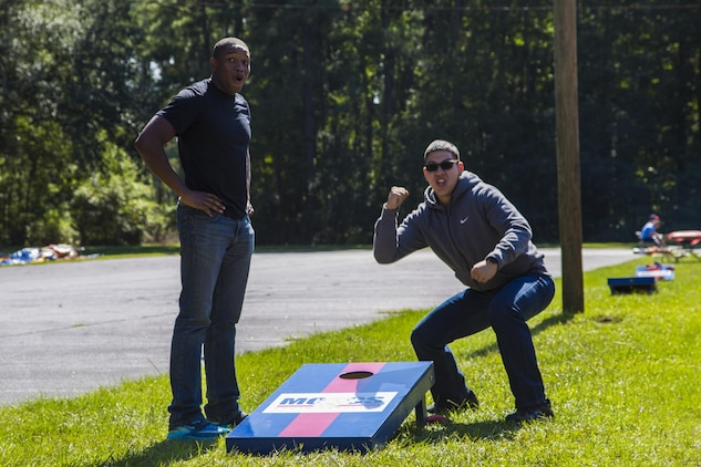 Marines play corn hole during the Headquarters and Headquarters Squadron fall festival at the chapel aboard Marine Corps Air Station Beaufort Oct. 17. Single Marines were invited to enjoy the day to promote a sense of camaraderie within the unit. The Marines are with H&HS.