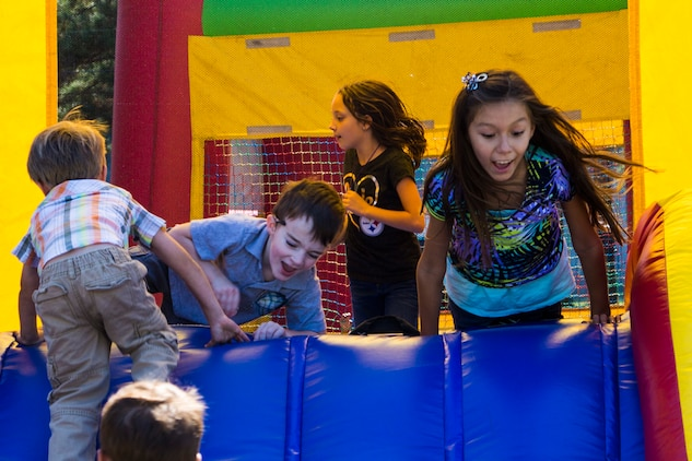 Children play on a slide during the Headquarters and Headquarters Squadron fall festival at the chapel aboard Marine Corps Air Station Beaufort Oct. 17. Senior Marines, junior Marines, spouses and children of all ages enjoyed this year's festival which lasted four hours.