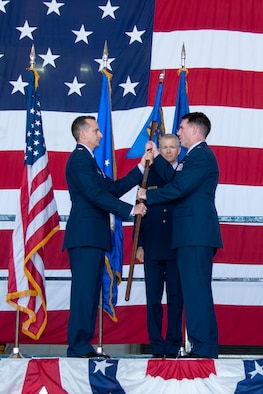 U.S. Air Force Reserve Col. Denis Heinz, commander of the 489th Bomb Group, presents the 345th Bomb Squadron's guidon to Lt. Col. Brian McClanahan on Oct. 17, 2015 at Dyess Air Force Base, Texas. McClanahan assumes command of the 345th Bomb Squadron, the only B-1 bomber unit in the Air Force Reserve. The 345th Bomb Squadron is assigned to the 489th Bomb Group which falls under the 307th Bomb Wing. The 307th Bomb Wing is the only dual bomber mission wing in the Air Force. (U.S. Air Force photo by Master Sgt. Laura Siebert/Released)