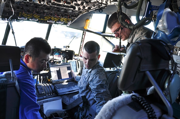 A Japan Maritime Self-Defense Force member works with Yokota technicians onboard a C-130R Hercules at Naval Air Facility Atsugi, Japan, Oct. 8, 2015. The Yokota technicians responded to the JMSDF request for support of four C-130R Hercules. (Courtesy photo by 374th Maintenance Group)
