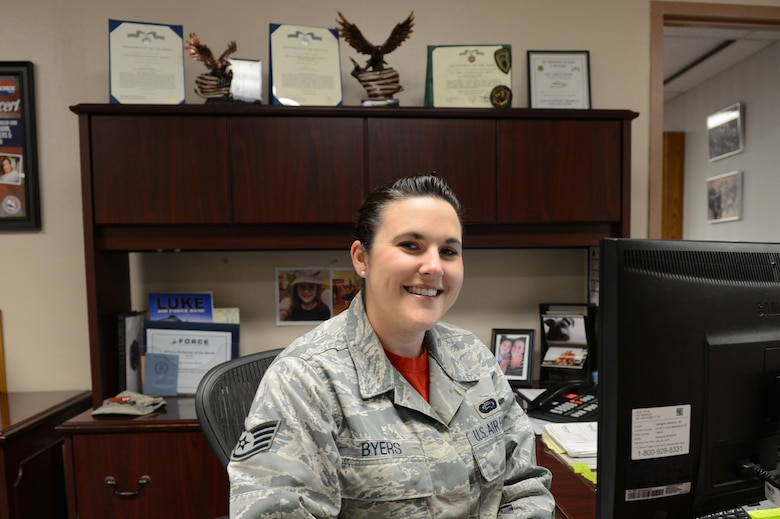 Staff Sgt. Ashley Byers, 56th Force Support Squadron NCO in charge commanders support staff, sits at her desk at Luke Air Force Base, Arizona, Oct. 16, 2015. Byers assists the 56th FSS commander in their objectives on a daily basis. (U.S. Air Force photo by Senior Airman James Hensley)