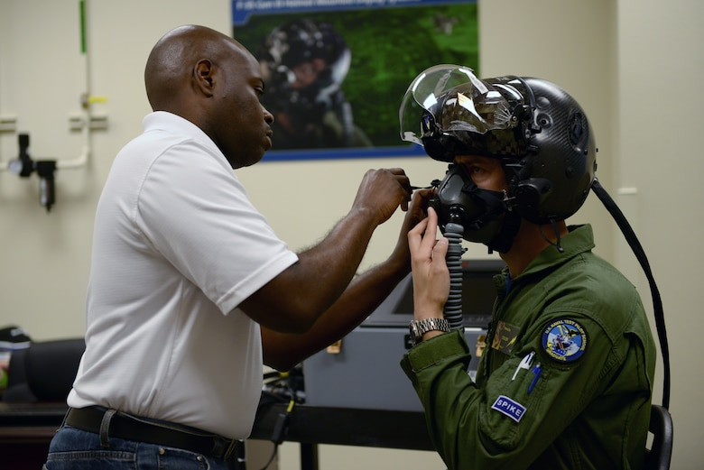 Christopher Culley, Rockwell Collins customer support specialst, fits and issues an F-35 Lightning ll Generation lll Helmet Mounted Display System at the Pilot Fit Facility at  Luke Air Force Base, Arizona, Oct. 16, 2015. The new system includes a number of upgrades, including improved night vision, optics and liquid-crystal displays. (U.S. Air Force photo by Airman 1st Class Ridge Shan)