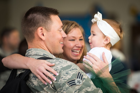(From the left) Senior Airman Jesse Strength, 726th Air Control Squadron weapons director, Wendi Strength and their daughter, Camden, share a moment Oct. 18, 2015 at Mountain Home Air Force Base, Idaho. Jesse spent six months in Southwest Asia with the 726th ACS supporting various missions throughout the region. (U.S. Air Force photo by Airman 1st Class Connor J. Marth)