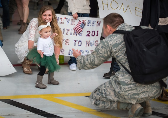 Camden Strength, daughter of Senior Airman Jesse Strength, 726th Air Control Squadron weapons director, walks to her father for the first time Oct 18, 2015 at Mountain Home Air Force Base, Idaho. Jesse missed her first steps while on a six-month deployment to Southwest Asia. (U.S. Air Force photo by Airman 1st Class Connor J. Marth)