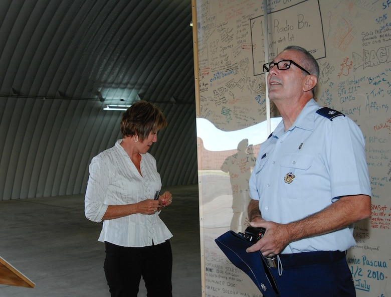 U.S. Air Force Reserve Lt. Col. Michael Fellows, Air Force Reserve chief of medical and retired U.S. Air Force Reserve Senior Master Sgt. Karen Loalbo view the Walls of Balad at the 309th Aerospace Maintenance and Regeneration Group, Davis-Monthan Air Force Base, Ariz., Oct. 16, 2015. Fellows and Loalbo last saw the walls in 2006 when they were deployed to Joint Base Balad, Iraq, and working in the Contingency Aeromedical Staging Flight facility. (U.S. Air Force photo by Staff Sgt. Angela Ruiz/Released)